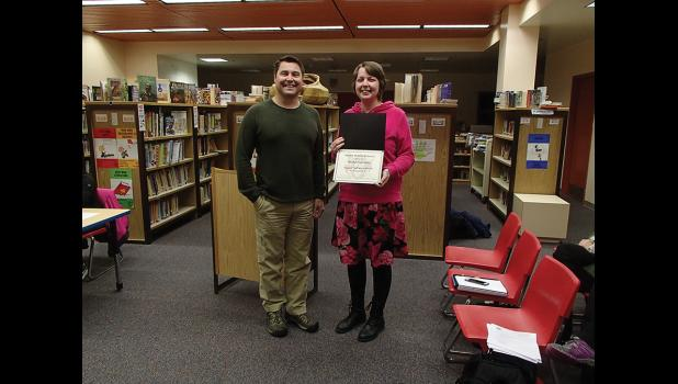 FAREWELL— Alisha Papineau is the Support Staff Member of the Month for February 2018. Superintendent Shawn Arnold, left, recognized Papineau for her long service with NPS. Papineau will be leave her position this month.