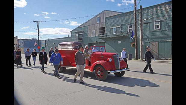 HONORING RICHARD— Pall bearers Kenneth Hafner, Boogles Johnson, Andrew Hafner, Bob Hafner, Nicholas Klescewski and Jake Kenick walk beside Richard Beneville's coffin during the memorial procession through Nome, on June 20.