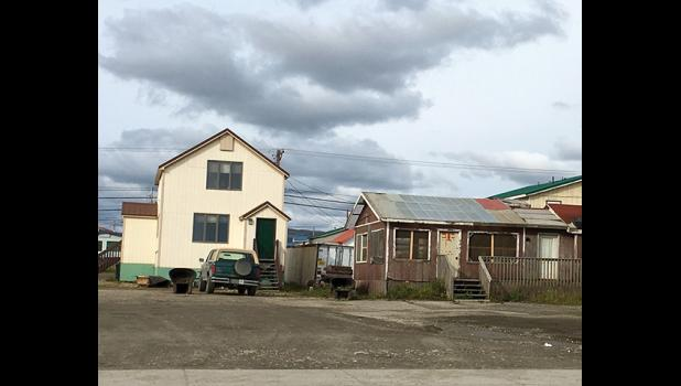 SAVED—For now. The Nome Common Council has given the owner of the structure on the right until Oct. 15 to achieve a list of work orders to save the solarium and cold storage from abatement.