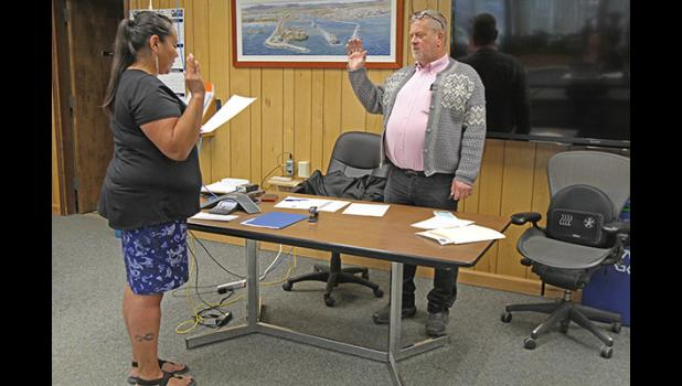 SWORN IN— Interim Mayor John Handeland takes the oath of office, on Tuesday, June 30.