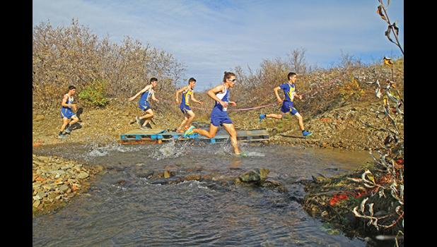 NOME XC INVITATIONAL— Boys Varsity race winner Tobin Hobbs, center, plots his move while running with the front pack of Kotzebue and Bethel runners in last Saturday's Nome Invitational cross-country race held at Nome-Beltz.