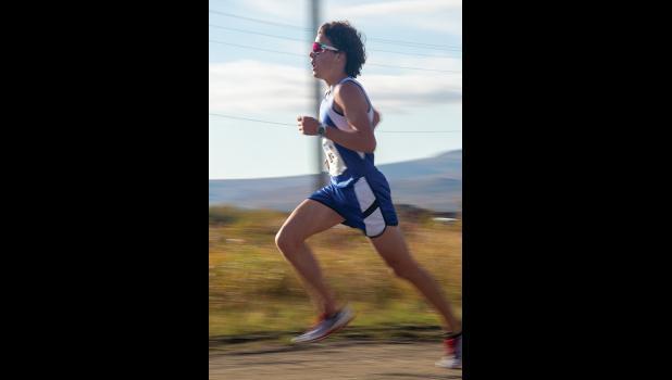Tobin Hobbs sprints to victory in the Varsity race.