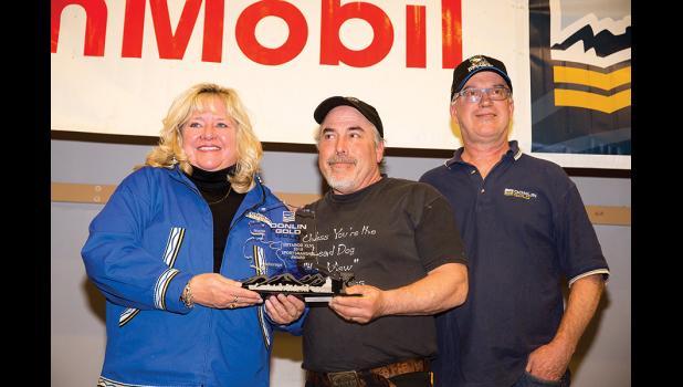 SPORTSMANSHIP— Scott Janssen, center, received the Sportsmanship award for saving Jim Lanier during a time of distress on the trail.