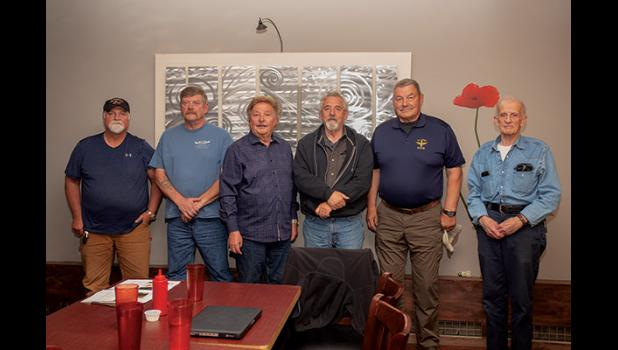 THE RESCUE— Survivors and rescuers of the dramatic air-sea rescue 25 years ago met for dinner Saturday evening in Nome. From left are rescuers Kevin Ahl, Randy Oles, survivor Dave Anderson and rescuers Terry Day, Eric Penttila and Vic Olson.