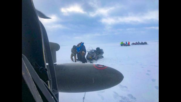An Alaska Army National Guard UH-60 Black Hawk helicopter aircrew performed a search and rescue mission for three Iditarod mushers about 25 miles east of Nome, March 20, 2020. The mushers and their dogs went through Bering Sea flood waters on the race trail and were wet and freezing. The aircrew transported two firefighter emergency medical technicians and Iditarod dog handlers to assist. The mushers were flown to Nome and transported to a local hospital. A local search and rescue team helped race dog handl