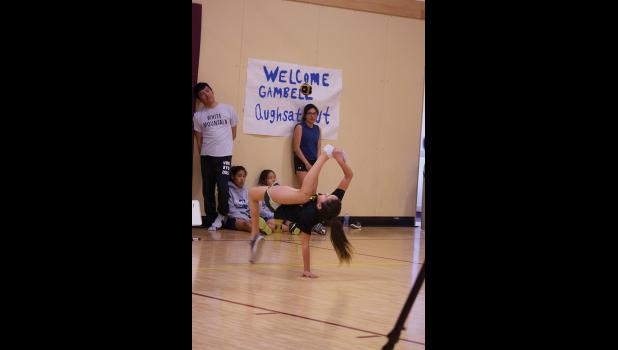 NYO— Unalakleet NYO athlete Summer Sagoonick shows remarkable flexibility as she makes an attempt in the Alaskan High Kick during last week's regional NYO games held in Shaktoolik.