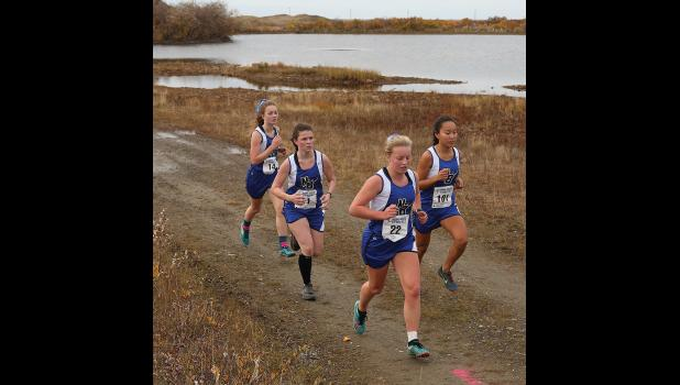 VARSITY WINNERS— Nome girls swept the podium at last weekend's Nome Invitational XC meet. Pictured are Ava Eartman, Mary Fiskeaux, Starr Erikson and Mallory Conger