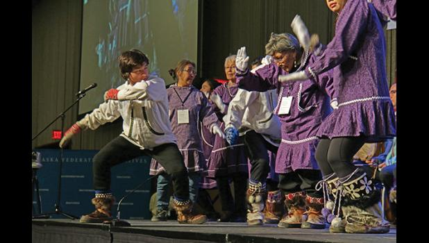 AFN QUYANA— Nome's David Miller joined the Kingikmiut Dancers and Singers of Anchorage to entertain the crowd during last week's Quyana dances at the Alaska Federation of Natives Convention in Anchorage.