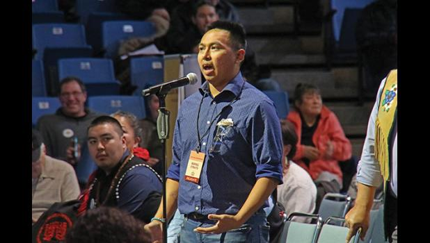 CLIMATE CHANGE RESOLUTION—Esau Sinnok speaks passionately in support of the Youth and Elders climate change resolutions at AFN.