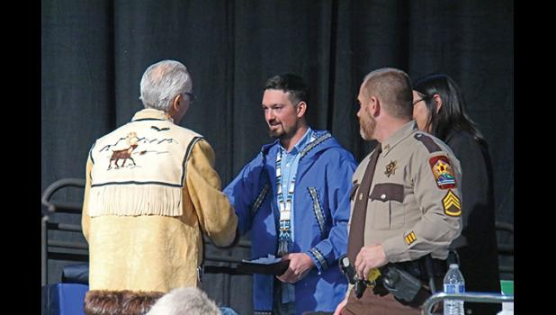 KEY NOTE— Pete Kaiser, 2019 Iditarod champion, receives gifts from Alaska Federation of Natives Co-chairman Will Mayo after his keynote address.