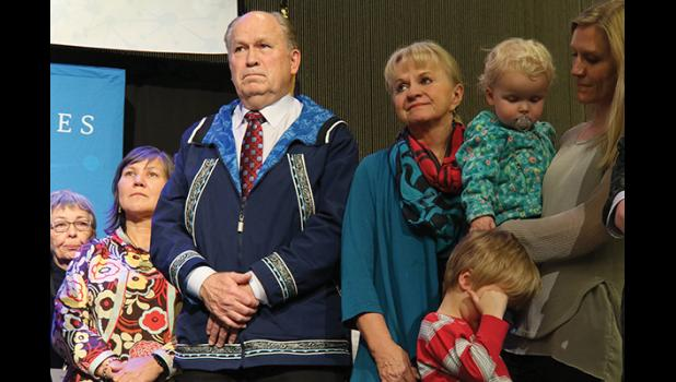 LISTENING— Lt. Gov. Valerie Davidson, Gov. Bill Walker, First Lady Donna Walker and daughter, Lindsay (Walker) Hobson on stage listening to various tribal representatives express their appreciation and sadness at Walker's announcement.