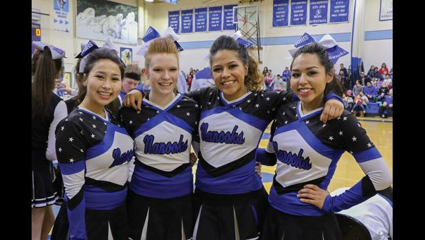 SENIOR SPIRIT— The four senior members on the 2016 Nome-Beltz Cheerleading Squad were recognized in front of the home crowd before their last peformance on Saturday.