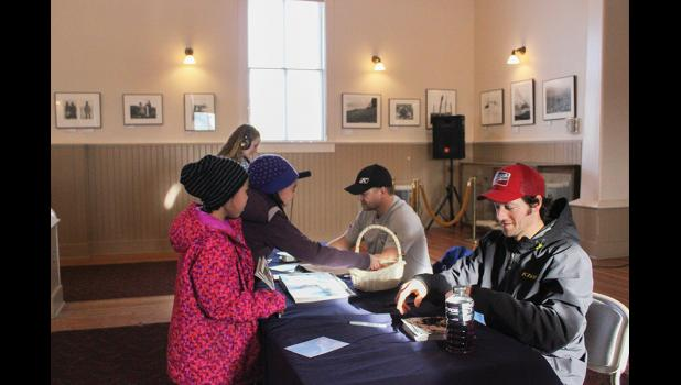 TEAMS AGAINST TOBACCO— Iron Dog racers Mike Morgan, right, and Chris Olds signed autographs and talked with young people about being tobacco free at Old St. Joe's on Wednesday, March 2