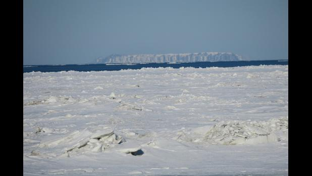 A bit of shorefast ice is still in place in front of Nome, but Norton Sound mostly shows open water.