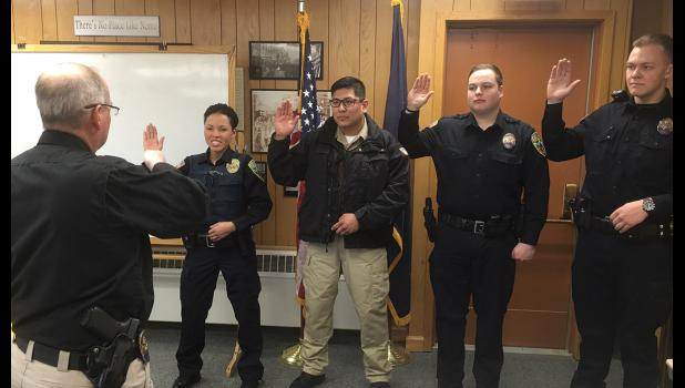 NEW RECRUITS— Nome Police Chief John Papasodora administers the oath to new police officers at the Nome Common Council meeting on March 27. Pictured left to right are Ofc. Crystal Toolie, Community Service Officer Tom Paniataaq, Ofc. Casey Johnson, Ofc. Cordell Murray.