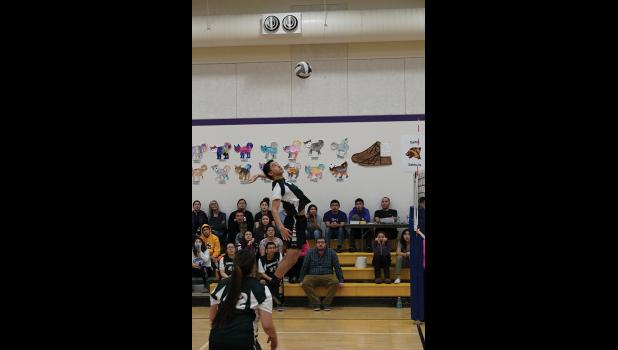 MIX SIX— Ed Kokeok of Shishmaref goes up for a hit against Unalakleet in the second state qualifying match of the Mix Six Volleyball tournament held in Golovin.