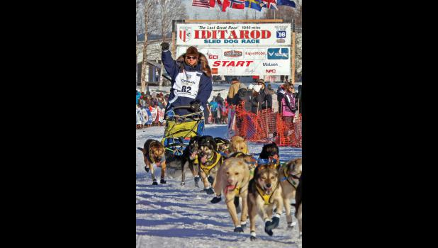 OFF TO NOME— Melissa Owens Stewart, formerly of Nome, leaves the start line in Willow on March 6.
