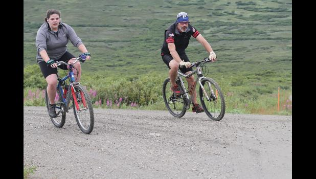 DEXTER CHALLENGE— Wyatt Earp Dexter Challenge bikers Elsa Hobbs and her father Daniel Hobbs round the corner to the finish line at Dexter after a 12-mile ride from town, during the annual run, bike and walk competition, held last Saturday.