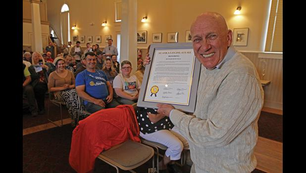 HONORING RICHARD BENEVILLE— Beneville was gifted with a citation from the Alaska State Legislature honoring his many contributions to Nome and the state, during the Richard Beneville Day celebration on June 22, at Old St. Joe's.