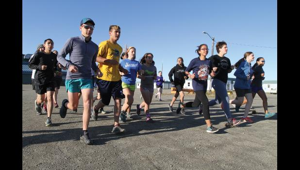 READY SET GO— The Nome Nanook XC team takes off behind the Nome-Beltz High School on a six-hour pledge run to raise funds for the traveling team, on Saturday, Aug. 26.