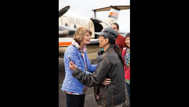 WELCOME TO SAVOONGA—  President of the Native Village of Savoonga Delbert Pungowiyi welcomes Senator Lisa Murkowski to Savoonga for the first ever Indian Affairs Field Hearing in the village.