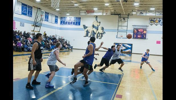NANOOKS VS ALUMNI— Nanooks and Nanook alumni do battle on the court on Saturday during the alumni tournament.