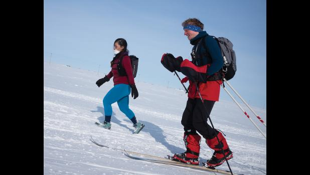 THE COLD TRAIL – Carol Seppilu and Max Romey make their way toward Nome from Safety on Saturday.