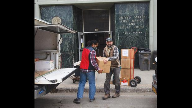 COURT MOVE—  Kekai Newman, left, and Bryce Rickers with Drake Construction transfer boxes of courthouse property to a pickup for transport to the new location as the Court moved last week to a temporary location at the Lutheran Church before it will relocate to its new permanent home at the old hospital.