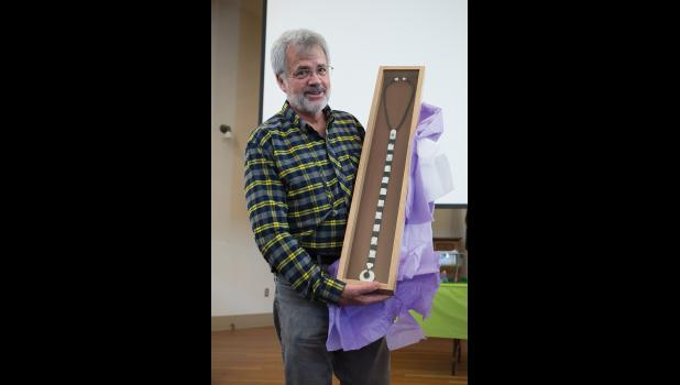 CELEBRATED— Dr. Head received a beautiful stethoscope created by Nome artist Joe Kunnuk during an appreciation event at Old St. Joe's on Saturday, April 7.