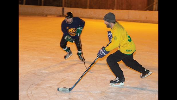 HOCKEY – Two hockey players enjoy the ice Friday on the Nome ice rink.