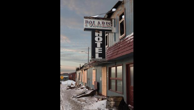 THE POLARIS— The shell of the burned out Polaris Hotel, bar and liquor store will be removed in the near future. A fire on Oct. 31 burned the hotel down and cost the life of Nomeite Bette Ann Haugen.