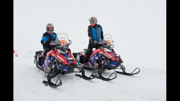Team 10, Morgan and Olds, won last year's Iron Dog. Here they are pictured arriving first in Nome.