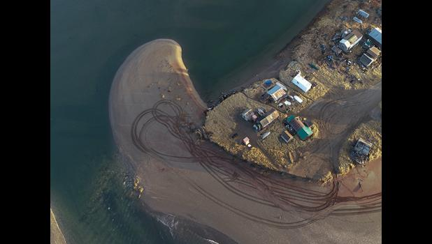 NEW LOOK – The eastern tip of the Fort Davis sand spit was eroded away and the Hukill cabin were washed upriver, and rests about half a mile upriver from the Nome River bridge.