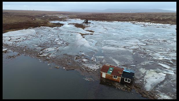The Hukill cabin was washed upriver and rests about half a mile upriver from the Nome River bridge.
