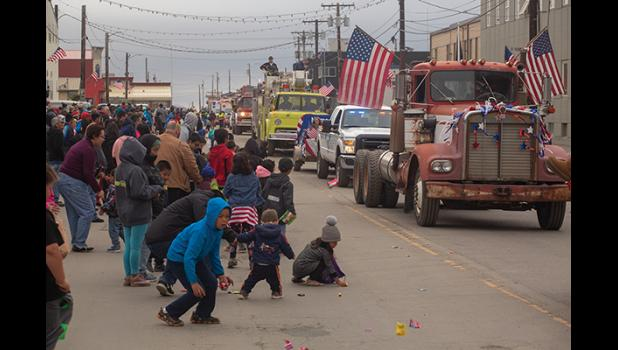 FOURTH OF JULY PARADE – Kids scramble for candy as the floats drift by during Nome's Fourth of July parade.