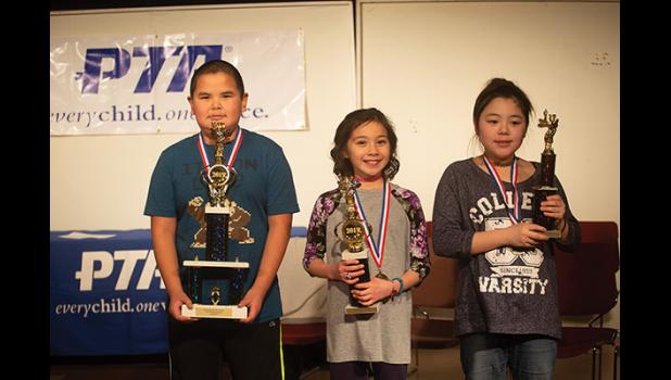 THREE SPELLERS – The top three in the Nome PTA's Spelling Bee are, from left, Gregory Kalerak, Peyton Lewis, and Melody Giang.