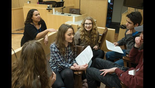 YOUTH COURT— Nome Youth Court director Pamela Smith explains to student volunteers how they will learn mediation in this exercise at the Nome Trial Court. From left clockwise are Ava Earthman, Katie Kelso, Maya Coler, Scott Santella of Anchorage's West High, and Marek Grieme of Kenai. The United Youth Courts of Alaska held their annual meeting in Nome last week.