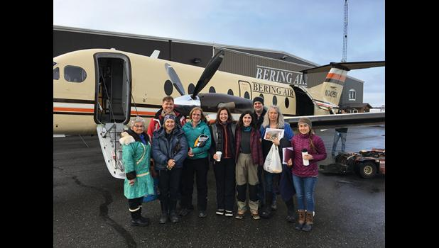 Representatives from HUD and other housing agencies spent a day in Nome and then flew to Savoonga to look at housing conditions there. From left they are Carol Piscoya of Kawerak, Coleen Bickford, Jeff McMorris, Carma Reed, Katy Miller, Lindsay Knots, Brian Wilson, Sue Steinacher of NEST and Megan Alvanna-Stimpfle, Principal Strategist Arctic Geopolitical Consulting.