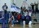 FAN CLUB— Fans of the Nanook Volleyball squad, lead by Andrew Hafner carrying the Nome-Beltz flag, cheer on the players during last weekend's matches that pitched the Nanooks against the visiting  Kotzebue Huskies.